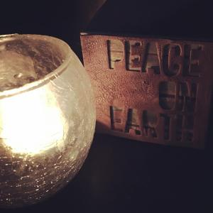 Peace On Earth A candle beside one of the drawers from my Advent calendar, which is soon to be filled with treats for my kids, but serves at the moment a reminder of the need for continued prayer.